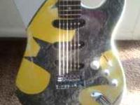 Looking to sell my electric guitar. Has the batman logo
