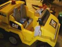 I am selling my sons battery powered Truck. It seats 2