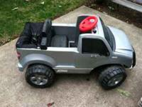 Ford f150 toy truck with charger runs good, tons of fun