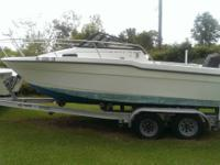 This is a Bayliner job boat for sale. 80 % restored.