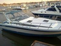 BOAT IS IN MARBLEHEAD OHIO. IN THE WATER AT A DOCK