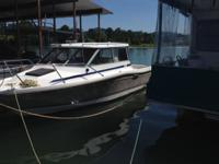 20ft. hard top,4 cylinder easy on gas,fish finder,trim