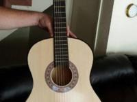 Brand new acoustic guitar! never been used. Was ordered