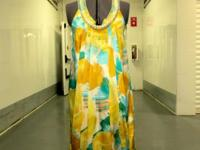 Beautiful silk dress by BCBG with crystal and pearl