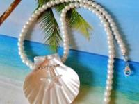 I handmake beach wedding jewelry and favors. Sand
