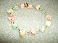 These are bracelets that I made. One is seashell with
