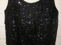 I have a beautiful black sequined & beaded camisole top