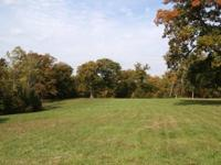 This 3.29 acre tract is secluded with an excellent