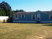 Well loved 3/2 Manufactured home on Beautiful 5 acres