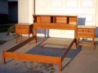 This bed set is made of solid maple with oak drawer