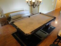 This is a lovely chestnut finish swimming pool table