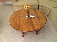 This lovely coffee table is Maple wood and has 2 drop