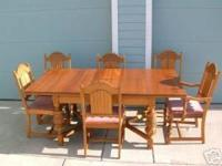 This set is a natural finished mahogany table with two
