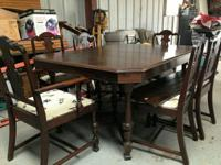 This is a beautiful antique dining room table in