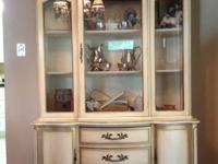 This is a French Provincial china cabinet. It has been