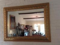 two mirrors, with beautiful carved antique frames.