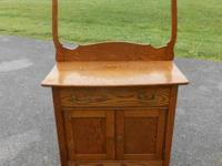 For sale here is a NICE OAK WASHSTAND WITH TOWEL BAR.