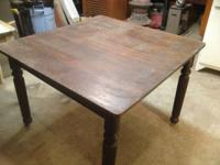 This is a beautiful antique walnut dining table. The