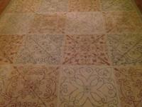 Beautiful 9' X 7 1/2 ' area rug. Tan, peach, green,