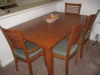 What a steal. Beautiful Birch Dining Room Table and 6