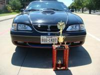 Beautiful black 1998 Mustang GT with several of the