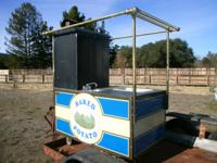 Beautiful brass concession cart built by Carts of