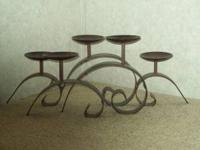 Beautiful brown metal iron candle holder. Holds 5