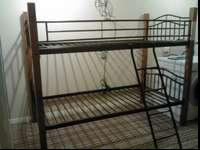 Beautiful Dark wood and Metal bunk beds with rails on
