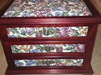 Cherry wood with flower pattern quilted design. Drawers
