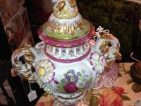 I have a beautiful double handle  Cherub/Floral Jar/Urn