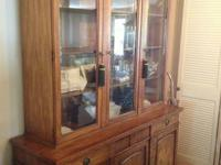 Beautiful China cabinet has separate top and bottom.