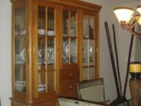 This is a gorgeous solid oak two - piece cabinet -