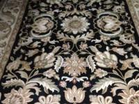 Selling this like-new area rug, 8 feet by 12 feet. The