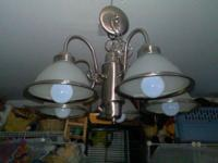Beautiful crome chandlier with 5 white glass shades