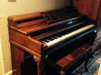 Beautiful upright piano with matching bench for