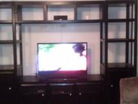 4 PIECE NEWLY OWNED ENTERTAINMENT CENTER W/ A DARK WOOD