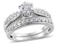 SELLING BRAND NEW DIAMOND WEDDING SET.....THEY ARE