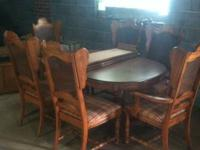 Dinning room table with 4 regular chairs and 2 captains
