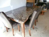 Faux granite top table and 4 leather chairs, like new
