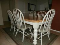 Gorgeous off white distressed dining room table which