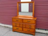 I'm selling a Beautiful Walnut Dresser with nice