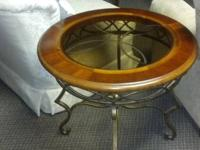 Very nice end table wrought iron base with glass top.