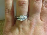 Lovely engagement ring and wedding event band for sale.