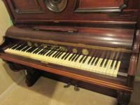 Beautiful Dark Wood Upright Piano and matching storage