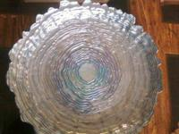 Glass Dish with scalloped edging around top.   Asking