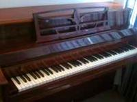 Very nice upright piano for sale in Charlottesville.