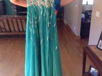 Size XS. $50/obo. Don't lose out on the excellent gown.