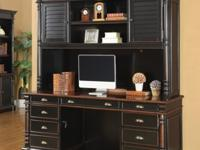 Finished in black & warm amber this home office