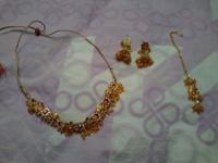 it is a complete set the necklace, earrings and