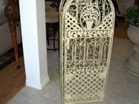 Here is A Beautiful Iron Ornate Large Wine Rack. This